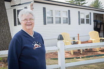 Woman standing in front of manufactured home