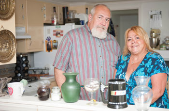 Couple standing in the kitchen of their manufactured home