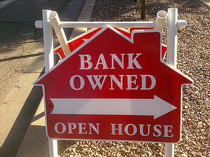 Photo of a sign for a bank-owned home sale
