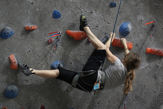 Woman on indoor rock climbing wall
