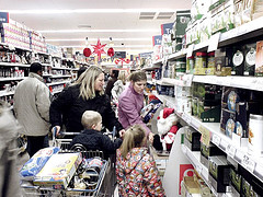 Women and children in the aisle of a crowded store