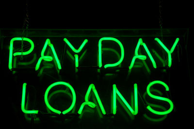 Green neon payday loans sign