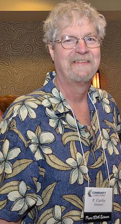 Man in Hawaiian shirt smiling