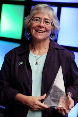NH Community Loan Fund President Juliana Eades holding the Gramlich Award
