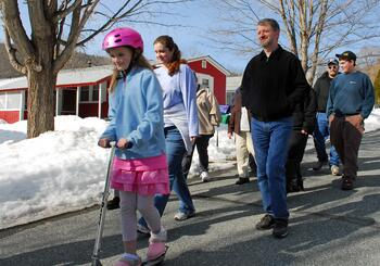 Mascoma Meadows residents walk as a group