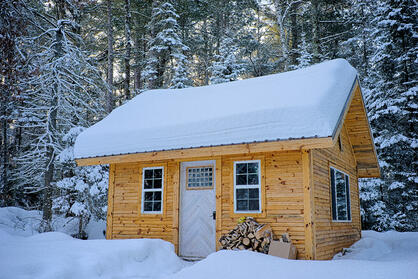 Snowy scene of a tiny house