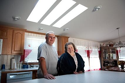 Elderly couple in their new manufactured home