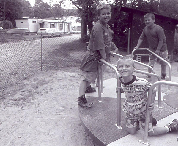Three boys at the Meredith Center Co-op playground.