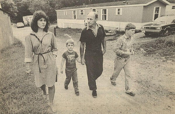 Jeff Sirles, second from left, holding his dad's hand in 1983.