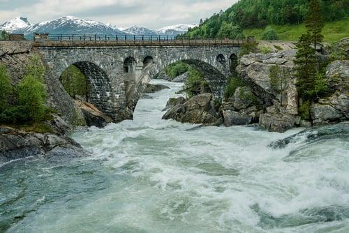 Granite bridge over roiling water