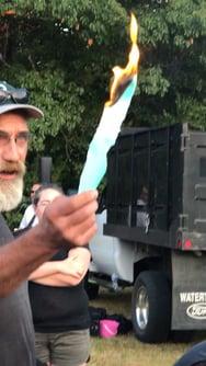 A man at Greenville Estates Tenants Cooperative burns its mortgage