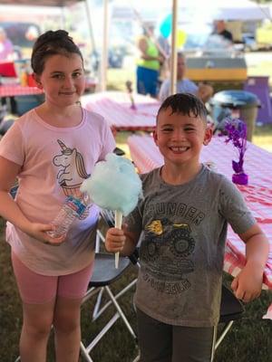 Two children enjoying cotton candy