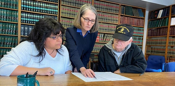 Two Fox Hill co-op officers and their lawyer review the closing documents