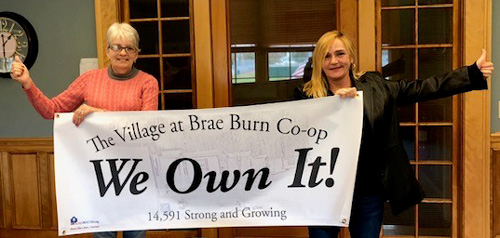Virginia Bourassa and Ola Gagne of The Village at Brae Burn Cooperative celebrate the purchase of their community