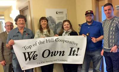 From left, Bill Norton of Norton Asset Management, Top of the Hill Secretary Barry Mulari and Vice President Linda Lord, S & M Properties President Carmella West, Top of the Hill President Charles Fairfield, and Tyler Labrie of ROC-NH.